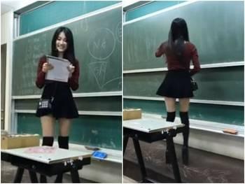 女老师穿短裙上课 美女教师超短裙 诱惑 弯腰露底春光乍泄图片