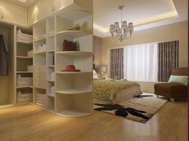 卧室入门处设计了一个l型小型衣帽间,还充当入门与休息区的隔断作用.图片