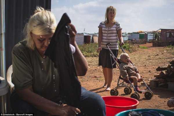 南非白人_南非种族隔离结束20年:白人住进贫民窟