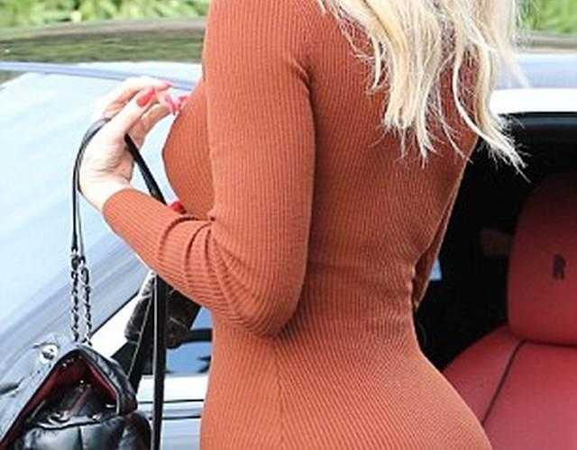 卡戴珊橘红贴身衣展丰臀肥乳